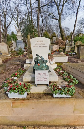 accumulations: PARIS, FRANCE - FEBRUARY 21, 2015: Tomb of Armand Fernandez (Arman) on Pere Lachaise Cemetery in Paris. Arman (1928-2005) was a French-born American artist best known for his accumulations and destruction and recomposition of objects