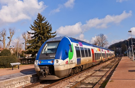 bombardier: PROVINS, FRANCE - FEBRUARY 22, 2015: AGC (Autorail Grande Capacite) Regional Train SNCF Class B 82500 in Provins, France. B 82500 is a hybrid, multi-system, electro-diesel multiple unit built by Bombardier Editorial