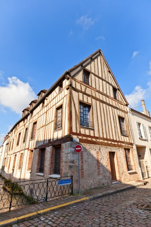 dupont: PROVINS, FRANCE - FEBRUARY 22, 2015: Medieval half-timbered (Fachwerk style) house on the bank of Voulzie river at Pierre Dupont street of Provins town, France. UNESCO World Heritage Site Editorial
