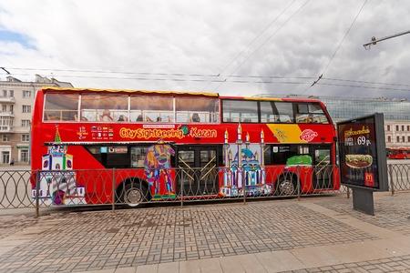 tatarstan: KAZAN, RUSSIA - APRIL 18, 2015: Famous red double-decker city sightseeing bus on the street of Kazan, Republic of Tatarstan, Russia Editorial