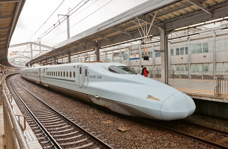 fast train: KOKURA JAPAN  MAY 18 2015: Japanese Shinkansen highspeed bullet train N700 series of JR Kyushu line near the platform of Kokura railway terminal in Kitakyushu town Japan. Maximum speed is 300 kmh Editorial