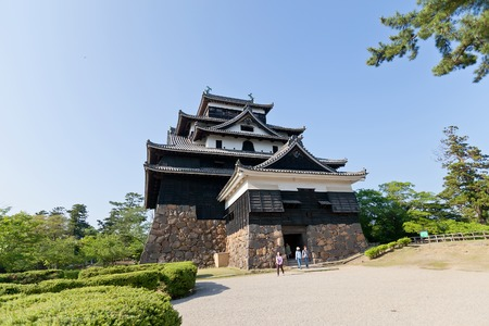 besiege: MATSUE JAPAN  MAY 19 2015: Main keep donjon of Matsue castle circa 1611 in Matsue Shimane prefecture Japan. One of 12 remaining medieval castles in Japan National Historic Site