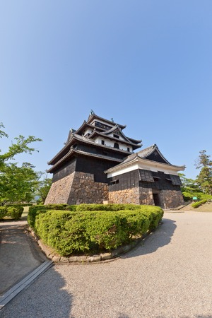 besiege: MATSUE JAPAN  MAY 19 2015: Matsue castle circa 1611 in Matsue Shimane prefecture Japan. One of 12 remaining medieval castles in Japan National Historic Site