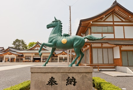 steed: HIROSHIMA JAPAN  MAY 20 2015: Horse statue of Gokoku Jinja Shinto Shrine in Hiroshima Japan. Founded in 1869 destroyed in 1945 reconstructed in 1965 Editorial