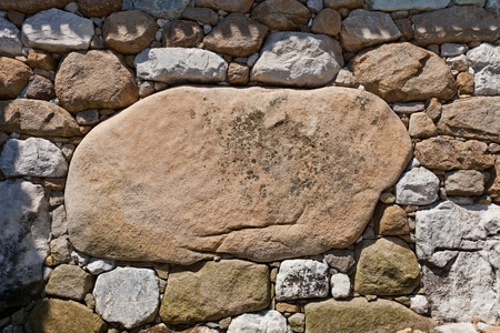 besiege: Huge Kanbeishi stone in the wall of Imabari Castle stronghold of Todo Takatora Shikoku Island Japan. Named after Kanbe Watanabe the chief of construction