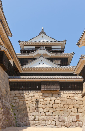 besiege: MATSUYAMA JAPAN  MAY 21 2015: Main keep donjon of Iyo Matsuyama castle circa 1854 Shikoku Island Japan. Important Cultural Property