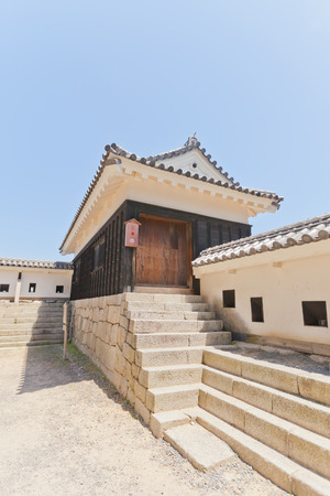 besiege: MATSUYAMA JAPAN  MAY 21 2015: South Turret of Third Gate rebuilt in 1854 of Iyo Matsuyama castle Shikoku Island Japan. Important Cultural Property