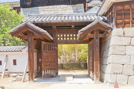 besiege: MATSUYAMA, JAPAN - MAY 21, 2015: Shichiku (Purple Bamboo) Gate (rebuilt in 1854) of Iyo Matsuyama castle, Shikoku Island, Japan. Important Cultural Property