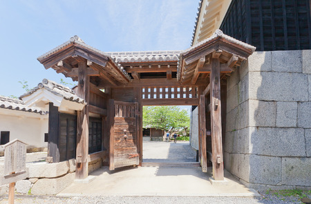 besiege: MATSUYAMA, JAPAN - MAY 21, 2015: Shikiri Gate (erected in 1603, rebuilt in 1854) of Iyo Matsuyama castle, Shikoku Island, Japan. Important Cultural Property
