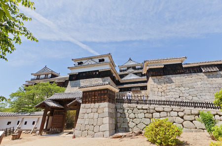 besiege: MATSUYAMA, JAPAN - MAY 21, 2015: Iyo Matsuyama castle (erected in 1603, reconstructed in 1854 and 1968), Shikoku Island, Japan. National Historic Site