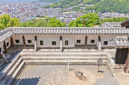 besiege: MATSUYAMA, JAPAN - MAY 21, 2015: Uchibei (Inner wall, rebuilt in 1854) of Shikiri Gate of Iyo Matsuyama castle, Shikoku Island, Japan. Important Cultural Property