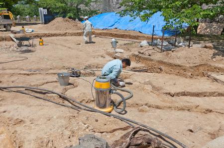 MATSUYAMA, JAPAN - MAY 21, 2015: Archeological works on the grounds of Iyo Matsuyama castle, Shikoku Island, Japan