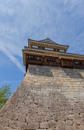besiege: MATSUYAMA, JAPAN - MAY 21, 2015: Minami-Sumi (South Corner) Turret (erected in 1603, reconstructed in 1968) of Iyo Matsuyama castle, Shikoku Island, Japan. National Historic Site