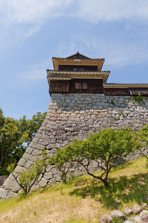 besiege: MATSUYAMA, JAPAN - MAY 21, 2015: Inui (Northwest) Turret of Iyo Matsuyama castle, Shikoku Island, Japan. Important Cultural Property