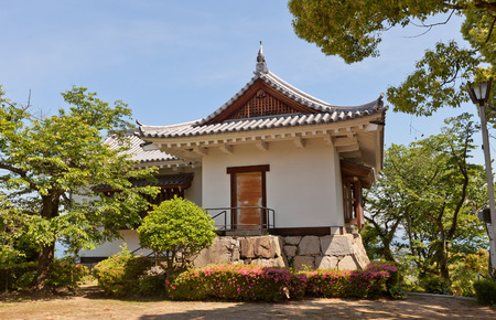 besiege: SHIKOKUCHUO, JAPAN - MAY 22, 2015: Watch tower of Kawanoe castle in Shikokuchuo city, Shikoku Island, Japan. Castle was erected in 1337, reconstructed in 1984