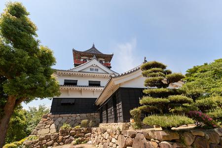 donjon: SHIKOKUCHUO, JAPAN - MAY 22, 2015: Main keep (donjon) of Kawanoe castle in Shikokuchuo city, Shikoku Island, Japan. Erected in 1337, reconstructed in 1984