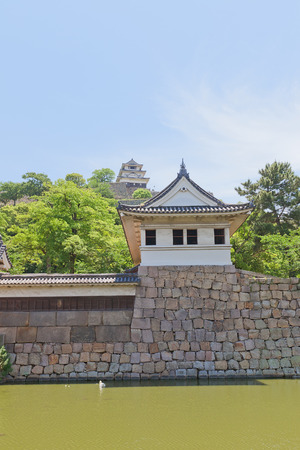 donjon: MARUGAME, JAPAN - MAY 22, 2015: Watch tower and main keep (donjon) of Marugame castle, Shikoku Island, Japan. One of only twelve survived original castles in