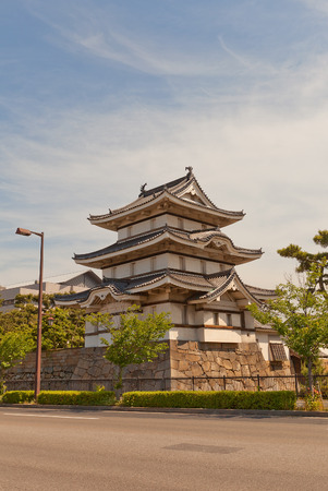 besiege: TAKAMATSU, JAPAN - MAY 22, 2015: Kitanomaru Tsukimi Yagura (Moon viewing) Turret (circa 1676) of Takamatsu castle, Shikoku Island, Japan. Important Cultural Property