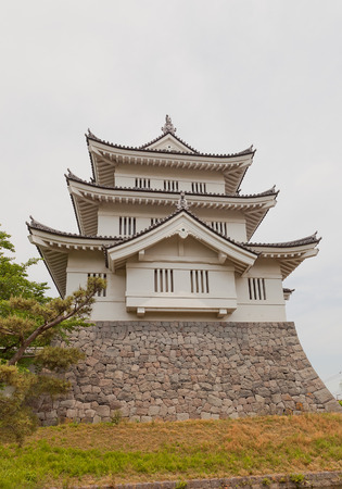 besiege: GYODA, JAPAN - MAY 24, 2015: Main keep (donjon) of Oshi castle in Gyoda town, Saitama Prefecture, Japan. Built in 1478 by Narita Akiyasu, reconstructed in 1988