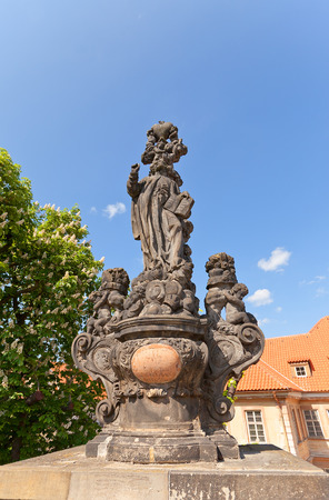 ferdinand: Statue of St. Cajetan circa 1709 on the balustrade of famous Charles Bridge in Prague UNESCO site. Sculptor Ferdinand Brokoff Editorial