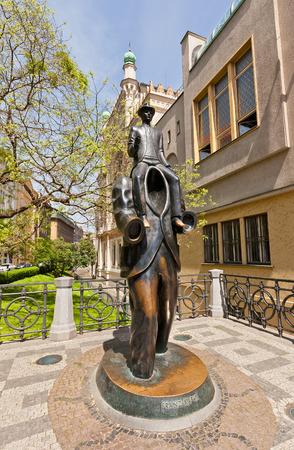 existentialism: PRAGUE, CZECH REPUBLIC - MAY 11, 2015: Unusual memorial of famous writer Franz Kafka in Jewish Quarter of Prague. Work of sculptor Jaroslav Rona, 2003