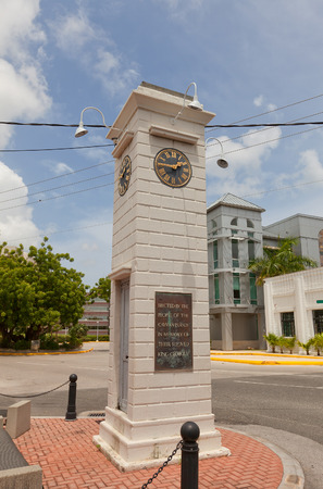 cayman: GEORGE TOWN, CAYMAN ISLANDS - JULY 05, 2015: Clock tower in George Town of Grand Cayman, Cayman Islands (British Overseas Territory). Erected in 1937 in memory of King George V Editorial
