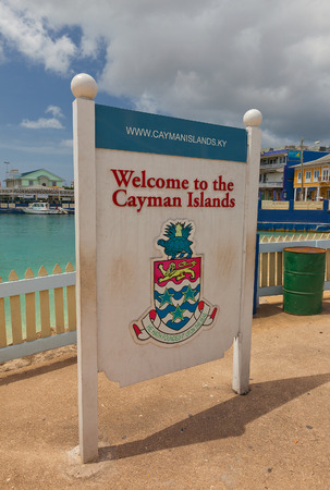 overseas: GEORGE TOWN, CAYMAN ISLANDS - JULY 05, 2015: Welcome board in George Town of Grand Cayman (British Overseas Territory). George Town is a popular port of call for cruise ships