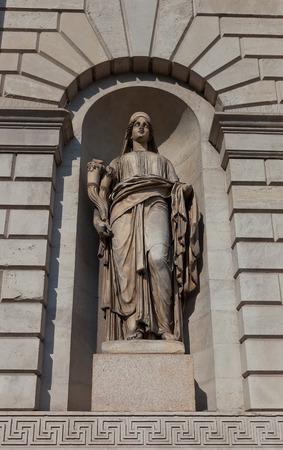 allegory: MILAN, ITALY - APRIL 10, 2015: Allegory statue of Wealth (Abbondanza) in the niche of old gateway Porta Venezia (circa XIX c.) in Milan, Italy. Sculptor Pompeo Marchesi