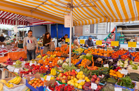 MILAN, ITALY - APRIL 11, 2015: Fresh fruits and vegetables trading in street market in Milan, Italy