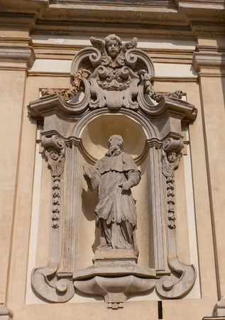 archbishop: MILAN, ITALY - APRIL 10, 2015: Statue of Charles Borromeo, the archbishop of Milan from 1564 to 1584, on facade of  Church of Santa Maria della Passione in Milan, Italy. Work of Giuseppe Rusnati, circa 1729