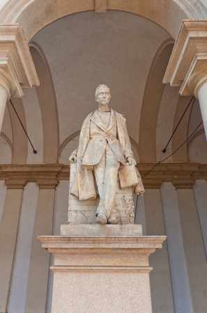 novelist: MILAN, ITALY - APRIL 11, 2015: Statue of Tommaso Grossi in the yard of Brera Art Gallery (Pinacoteca di Brera) in Milan, Italy. Tommaso Grossi (1791-1853) was an Italian poet and novelist