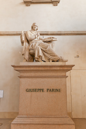 MILAN, ITALY - APRIL 11, 2015: Monument (circa XIX c.) to Giuseppe Parini in the corridor of Brera Art Gallery (Pinacoteca di Brera) in Milan, Italy. Giuseppe Parini (1729-1799) was an Italian Enlightenment satirist and poet of the neoclassic period