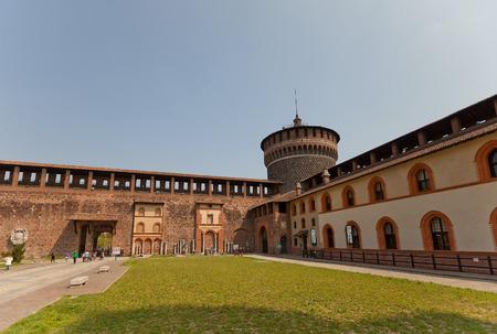 sforza: MILAN, ITALY - APRIL 11, 2015: Corner tower and walls of Sforza Castle (Castello Sforzesco, circa XV c.) in Milan, Italy.  View from inner yard
