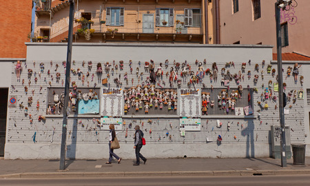 MILAN, ITALY - APRIL 11, 2015: Wall of Dolls art installation in Milan, Italy. A message from the Fashion World against violence on women. Dolls made by international fashion brands and designers