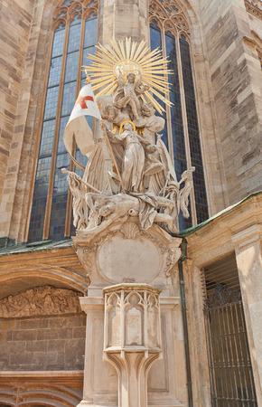 ecclesiastical: VIENNA, AUSTRIA - AUGUST 12, 2015: Capistran Chancel (circa XVIII c.) of Cathedral of Saint Stephen in Vienna, Austria. Statue shows St. Francis under an extravagant sunburst, trampling on a beaten Turk Editorial