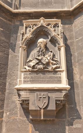 ecclesiastical: VIENNA, AUSTRIA - AUGUST 12, 2015: Memorial plaque (circa 1894) of Friedrich von Schmidt on the tower  of Cathedral of Saint Stephen in Vienna, Austria. Schmidt (1825-1891) was famous architect of Vienna Editorial