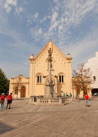 ecclesiastical: BRATISLAVA, SLOVAKIA - AUGUST 16, 2015: Church of Saint Steven Capuchin (circa 1711) on SNP Square of Bratislava, Slovakia. Column in front of the church (circa 1723) supports a statue of Virgin Mary
