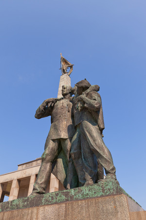 liberating: BRATISLAVA, SLOVAKIA - AUGUST 22, 2015: Right sculpture group of Slavin war memorial (circa 1960) for Soviet soldiers who fell while liberating Bratislava. National Cultural Monument of Slovakia. Sculptor Jan Kulich