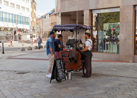 cart: BRATISLAVA, SLOVAKIA - AUGUST 24, 2015: Coffee Brothers retro style mobile bicycle coffee cart in Bratislava, Slovakia