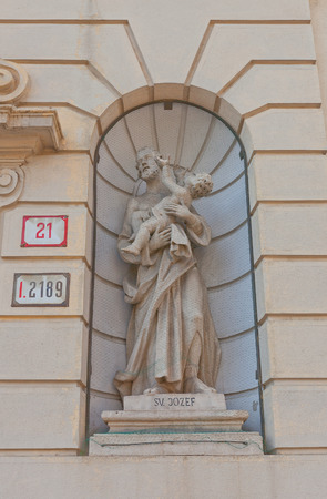 infant jesus: BRATISLAVA, SLOVAKIA - AUGUST 24, 2015: Statue of St Joseph on the facade of church of convent of Order of the Sisters of St Elizabeth (circa 1745) in Bratislava, Slovakia. Joseph holds infant Jesus Editorial