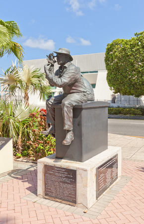 cayman: GEORGE TOWN, CAYMAN ISLANDS - SEPTEMBER 12, 2015: Sculpture called Tradition (circa 2003) on Heroes Square in George Town of Grand Cayman (British Overseas Territory). Sculptor Simon Morris Editorial