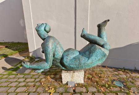 czech women: PRAGUE, CZECH REPUBLIC - NOVEMBER 02, 2015: Sculpture Women in the Sun in Prague. Bronze copy made in 2005 from 1958 artwork of Eva Kmetova Editorial