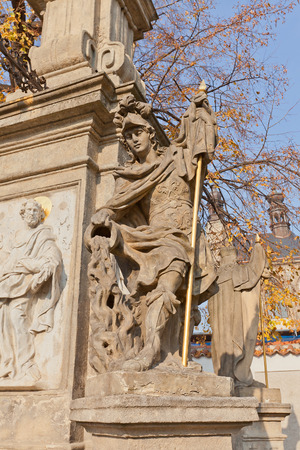 unesco in czech republic: KUTNA HORA, CZECH REPUBLIC - NOVEMBER 04, 2015: Sculpture at the foot of the Monument to John of Nepomuk near the Cemetery Church of All Saints in Sedlec. UNESCO World Heritage Site Editorial