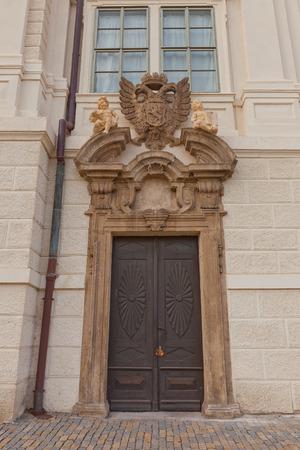 jesuit: KUTNA HORA, CZECH REPUBLIC - NOVEMBER 04, 2015: Decorated portal of side entrance of the Jesuit College (circa 1667) in Kutna Hora (UNESCO site). Architect Giovanni Domenico Orsi Editorial