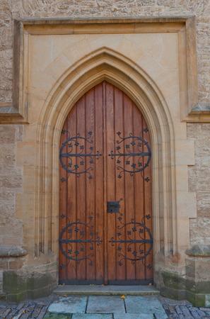 unesco in czech republic: KUTNA HORA, CZECH REPUBLIC - NOVEMBER 04, 2015: Side door of the Cathedral of Saint Barbara (circa XIV c.) in Kutna Hora town, Czech Republic. UNESCO World Heritage Site