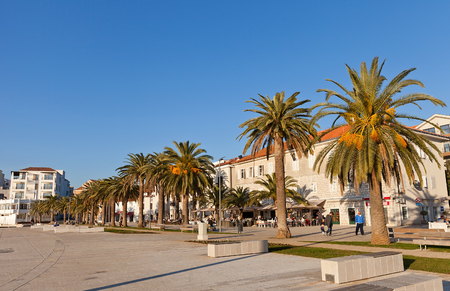 paseo: TIVAT, MONTENEGRO - DECEMBER 23, 2015: View of the quay paseo of Tivat town, Montenegro. Popular place for leisure among tourists and citizens
