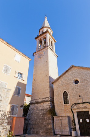 ecclesiastical: BUDVA, MONTENEGRO - DECEMBER 26, 2015: Bell tower of Church of St John the Baptist in Old Town of Budva, Montenegro. Founded in VII c., reconstructed in XII-XX cc. Landmark and symbol of Budva town