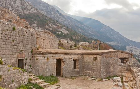 impregnable: KOTOR, MONTENEGRO - JANUARY 02, 2016: Ruins of St John (Sveti Ivan or San Giovanni) castle on the St. John Mountain in Kotor, Montenegro. Erected in XV c. by Venetians. World Heritage site of UNESCO