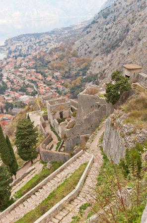impregnable: KOTOR, MONTENEGRO - JANUARY 02, 2016: Walls of St John castle on the St. John Mountain in Kotor, Montenegro. Erected in XV c. by Venetians. World Heritage site of UNESCO