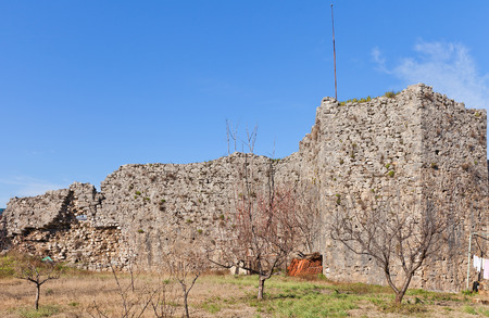 confluence: PODGORICA, MONTENEGRO - JANUARY 23, 2016: Ruins of Depedogen Fortress (Nemanjin Grad) in Podgorica, Montenegro. Erected in 1477 by Ottoman Empire above the confluence of Ribnica and Moraca rivers Stock Photo